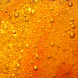 Orange. A macro shot of bubbles within a bottle of detergent royalty free stock photography