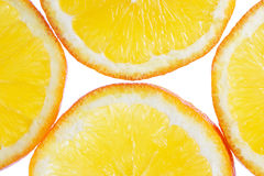 Orange. Cut into pieces,vegetarian, vitamin, white, yellow Stock Photos