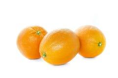 Orange. Composition of three oranges on a white background stock photos