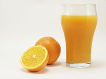 Orange. S and glass of  juice on a white background Royalty Free Stock Images