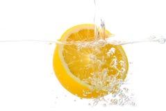 Orange. Fresh orange in water,isolated background Royalty Free Stock Photography