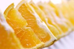 Orange. Many Pieces of a juicy orange royalty free stock photography