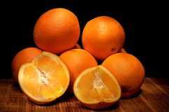 Orange. ? half of  with black background Royalty Free Stock Photography