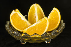 Orange. Slices in a fancy glass bowl with black background stock image