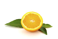 Orange. Sliced orange on green leafs isolated on a white background Royalty Free Stock Images