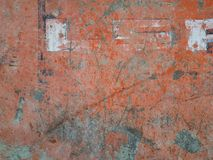 Orange abstract background with green spots and gray scratches. Stock Photography