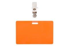 Orange Abzeichen mit Metallclip Lizenzfreie Stockfotos
