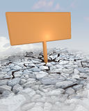 Orange Advertisement Board Stuck In Rocky Ground Royalty Free Stock Photography