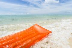 Orange air mattress in the sea Stock Photo