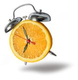 Orange alarm clock ringing Royalty Free Stock Image