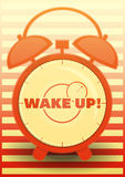 Orange Alarm Clock with text: Wake up! Stock Photography