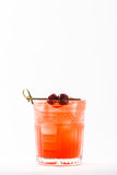 Orange alcohol cocktail with berries Stock Photography