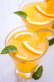 Orange alcohol cocktail on a wooden table. Royalty Free Stock Photo