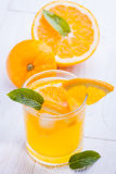 Orange alcohol cocktail on a wooden table. Royalty Free Stock Photography