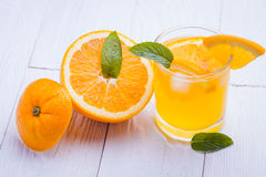 Orange alcohol cocktail on a wooden table. Royalty Free Stock Images