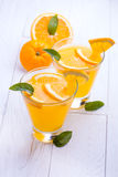 Orange alcohol cocktail on a wooden table. Stock Photos