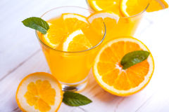Orange alcohol cocktail on a wooden table. Stock Photo