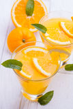 Orange alcohol cocktail on a wooden table. Stock Photography