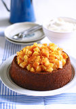 Orange almond cake. A whole sponge cake topped with navel orange compote Stock Image