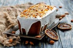 Orange almond cake on a bronze tray. Stock Image