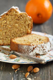 Orange and almond cake on a plate. Royalty Free Stock Image