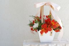 Orange Alstromeria - Flowers. Paper Basket Arrangement of Orange Red bouquet Composition Gift Flowers. White Background. Copy spac. Orange Alstromeria - Flowers Stock Photography