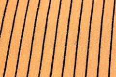Orange alternating black fabric. Stock Photo