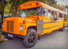 Orange american bus turned into mobile fast food Stock Image