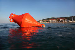 Orange anchor buoy floats on the sea. Stock Photography