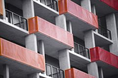 Free Orange And Red Balconies On Modern Concrete High-rise Building W Stock Photo - 116906360