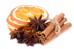 Orange, anise and cinnamon. Sliced dried orange with cinnamon sticks and anise Royalty Free Stock Photos