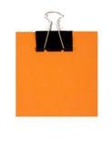 Orange Anmerkung und schwarze Heftklammer Stockbild