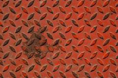 Orange anti-bakgrund för textur för snedstegmetallgolv arkivbild