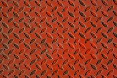 Orange anti-bakgrund för textur för snedstegmetallgolv Rost på stål royaltyfria bilder