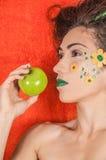 Orange Apfel stockbilder