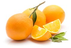 Orange, appelsin isolated. Oranges isolated on white background three whole two sliced quarters green leaves Royalty Free Stock Photos