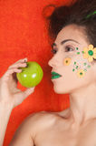 Orange Apple. Beautiful model representing the spring colors orange and green holding a green apple representing healthy lifestyle Stock Photos
