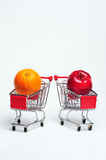 Orange and Apple. In a shopping cart Stock Images