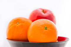 Orange with apple. Orange with apple in the bowl stock photo
