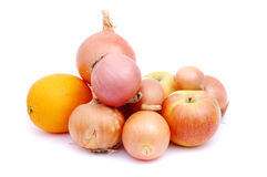 Orange and apple in a bunch of onions Royalty Free Stock Photos
