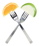 Orange and Apple on Forks Stock Photos
