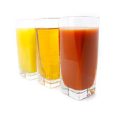 Orange apple and grape juice in glass Royalty Free Stock Photography