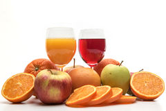 Orange, apple and grapefruit juice and fruits Royalty Free Stock Images