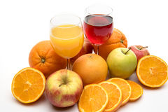 Orange, apple and grapefruit juice and fruits Royalty Free Stock Photography