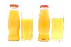 Orange and Apple Juice. Isolated on White royalty free stock image