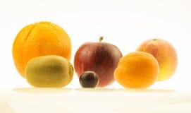Orange, apple, kiwi, peach nectarine and one grape. Different fruits in white backround royalty free stock photo