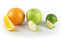 Orange Apple Lime fruits. Orange apple and lime fruits with eighth slice in front Royalty Free Stock Images