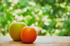 Orange and apple stock images