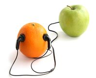 Orange and an apple player Royalty Free Stock Photos