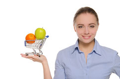 Orange and apple in shopping trolley on the palm Royalty Free Stock Photos
